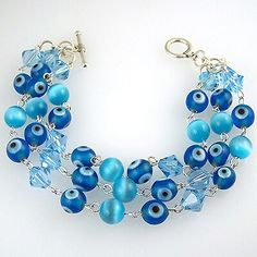 In the art of evil eye jewelry making, it's either an evil eye bead is used as the central point of a jewelry, or several evil eye beads make up the jewelry Simple Bracelets, Cute Bracelets, Gemstone Bracelets, Handmade Bracelets, Handmade Jewelry, Diy Jewelry, Jewelry Making, Evil Eye Jewelry, Evil Eye Bracelet