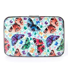 """Butterfly Armored wallet Keep your essentials organized and protected with this wallet featuring an RFID shield and electromagnetic sleeve that safeguard your personal information. 4.5 """"wide x 3 """" High x .5 """"deep. Metal .Snap closure. Standard wallet pockets fig design group Bags Wallets"""