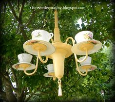 teacups chandelier, not sure though how it works out with candles? can you even see them?