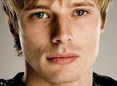 King Arthur Pendragon-Bradley James    King Arthur Pendragon-short sandy blonde hair, sea foam shade of green eyes, 6'0 and very muscular, wears long tunics and mail chain, (Shadow serves under his control as a knightress to the lady Morgana.)