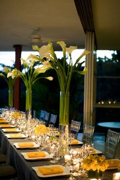 Lovely arrangements of cala lillies in tall crystal vases
