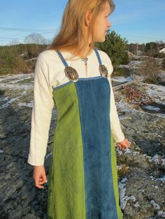 Apron-dress with pleated front panel. Inspired by the Kostrup find. By Nille Glaesel - another example of using more than one color