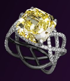 "I am in LOVE with this ring!!! ""Ruban"" or ribbon by Parisian jeweller Lorenz Baumer.  7.29 carat canary diamond"