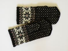 High quality hand knitted warm wool mittens , gloves patterned black and white. $50.00, via Etsy.