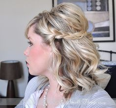 Tutorial here! http://www.thesmallthingsblog.com/2011/10/half-up-braids.html