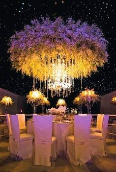 Breathtaking #floral #hanging #centerpiece blending exquisitely with the #stringlights ...
