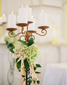 candelabra with ribbons and flowers