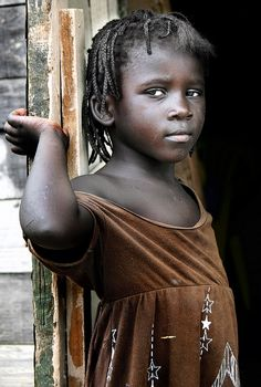 The Other Haiti by psychiatrist's view, via Flickr. Little girl living slums outside of San Pedro in the Dominican republic. Her parents were Haitian refugees.