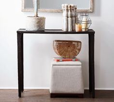 The slim Jamie Console Table from Pottery Barn packs major style. The deeply textured surface gives it a sculptural presence that's the perfect look to elevate your entryway decor.
