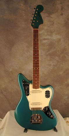 1965 or 66 Fender Jaguar, in Ocean Turquoise with dot inlays and bound neck. #acousticfenderguitar