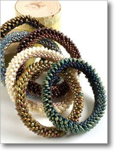 Dragon Bangle by Nancy Jones. Uses several different stitches  http://www.interweavestore.com/Bead/Patterns/Dragon-Bangle.html?SessionThemeID=18