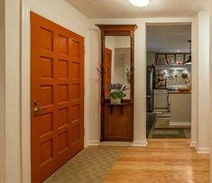 Hooke on Houses   GA Condo: Mirrored coat rack in entryway
