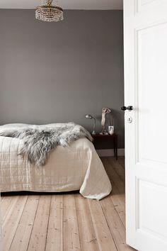 Beige parquet, Grey Wall, White bed