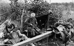 Cossaks Wehrmach repairing their saddle`s - Russia May 1943