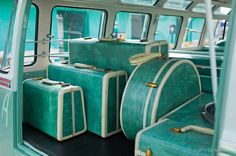 I need this vintage teal luggage, in a teal bus with a teal building in the background. too good to be true.