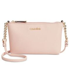 Cut from fine Saffiano leather, this elegantly designed crossbody goes from day to date night with shiny chain accents and signature lettering. From Calvin Klein. | Imported | Saffiano leather | Cross