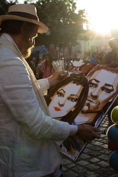 Artist holding his art