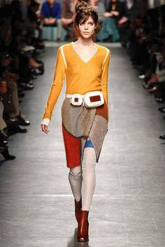 Stained glass patterns muted by wools with marigold slim sweater, new take in the waist pack and a new take in Prada's previous sweater thigh highs obsession. Slouchy vibrant cool.  Missoni Fall 2014 Ready-to-Wear Collection Slideshow on Style.com