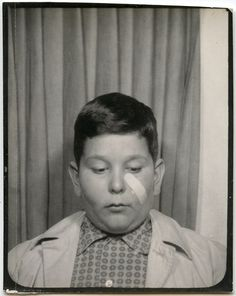 Band Aid.  Photobooth from the collection of Angelica Paez. Little boy in photo booth with Bandaid on his cheek. Vintage Photos I Love.