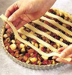 Harvest Fruit Tart  ingredients    1 recipe Pastry for Lattice-Top Pie  1-2/3 cups apple juice or apple cider  3/4 cup snipped dried apricots or peaches  3/4 cup snipped dried pitted plums (prunes)  1/2 cup dried tart cherries or raisins  1/3 cup packed brown sugar  1/4 cup all-purpose flour  1/4 teaspoon ground nutmeg  1 cup chopped, peeled cooking apple or pear  1/2 cup broken walnuts  Milk (optional)  Granulated sugar (optional)  directions    Prepare and roll out Pastry for Lattice-Top…