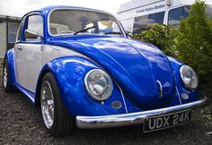 A blue & white VW beetle.  Taken at Alive &V-Dubbin 2009 bug festival at  Stonham Barns, Suffolk (UK).