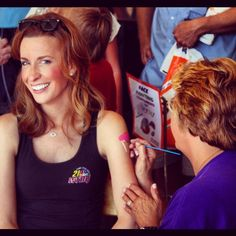 Looks like WFMJ Today's Lauren Lindvig is getting a temporary tattoo during Youth Day at the Canfield Fair!