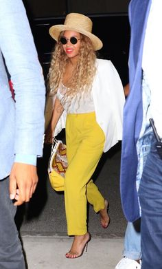 Yes, Queen Bey's latest look is without question an ode to Lemonade, but that aside, it's just totally chic outfit inspo. We're loving the summery-yet-polished combination of her straw hat, white tank, blazer worn on the shoulders, and sharply-tailored trousers.