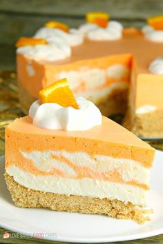 This No-Bake Orange Creamsicle Cheesecake is a nostalgic bite of bright orange and creamy vanilla, reminiscent of those long-gone summer days of your childhood. No-Bake Orange Creamsicle Cheesecake --- PIN THIS RECIPE --- As much Orange Cheesecake Recipes, Cheesecake Desserts, No Bake Desserts, Easy Desserts, Delicious Desserts, Easter Cheesecake, Nutella Cheesecake, Light Desserts, Orange Creamsicle Cheesecake Recipe