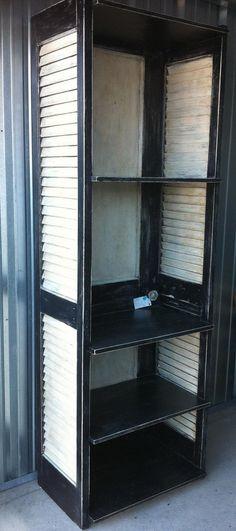 Repurposed Shelving Unit Made from Door.