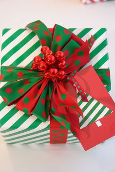 Festive green and white gift wrap with fun berry and bows topper!