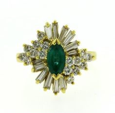 Ring features an approx. 0.60ct marquis emerald surrounded by approx. 1.00ctw of round and baguette diamonds. Ring size 6.75, top measures 18mm x 19mm. Marked 750, KG. Weight - 8.3 grams. Gemstones have not been graded for color and clarity ,and tested for  clarity and color enhancement, unless stated otherwise. Watches are guaranteed to be in running order, if described as such, at the time of listing only. Watches have not been tested for features functionality, unless otherwise stated in…