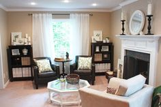 I love the beige paint with the contrasting white and dark browns with a splash of green accents.