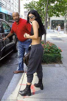Taking tips from Kanye? Kylie Jenner rocked harem style pants with biker boots as she stepped out in New York on Friday