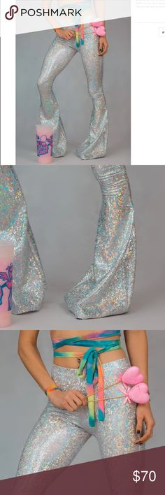 """Disco flares iheartraves bell bottoms 70's rave Disco Flares size XS. Brand new, brand is eatsleeprave and sold out. Semi high waisted, waist/hips measures 24-36 in. they are 42"""" long, best for someone slim/taller, my knee circumference/calves are 12-13"""" and feel a bit tight so skinnier legs are best. Made from holographic metallic silver hologram material made from nylon and spandex .""""shattered glass"""" frost bite pattern. Similar to unif dollskill mi gente coquetry clothing wild fox ocean…"""