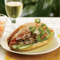 Grilled-Chicken Banh Mi - This popular Vietnamese sandwich combines sweet, sour, crunchy and soft in one delicious—and portable—package Chicken Sandwich, Sandwich Recipes, Vietnamese Chicken Salad, Vietnamese Sandwich, Vietnamese Food, Vietnamese Recipes, Grilling Recipes, Wine Recipes, Gourmet