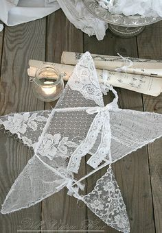 "two wire coat hangers (tops trimmed off) + old lace + a little extra wire to make a ""v"" = sweet vintage lace / doilie star to hang anywhere... love"