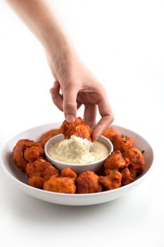 These Buffalo cauliflower wings are baked, not fried and also gluten-free. They're so easy to make and a super healthy snack, appetizer or side.