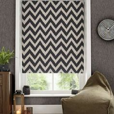 Featuring a textured zig zag design in natural and charcoal tones for a modern look, this patterned roller blind is crafted with blackout lining to reduce external light entering your room.