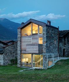 rocco borromini adds timber façade to stone ruins to create SV house in northern italy
