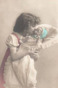 lightly tinted photo of girl with her doll