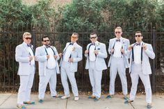 Tan and navy topsiders are a great accessory for summer groomsmen. Finish off with suspenders and a lightweight suit for a more relaxed wedding look!