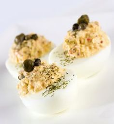 Chris' deviled eggs really pack a punch! This take on traditional deviled eggs is loaded with spice as it calls for cayenne, cardamom, coriander, cumin and curry powder.