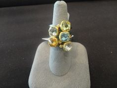 Black rhodium sterling silver and yellow gold multi color stone stackable rings. Available at www.yanina-co.com, 800-780-3433.