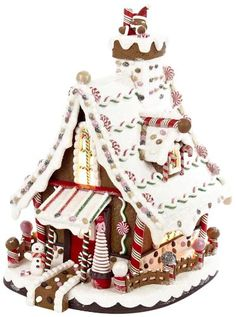 "Add a sweet touch to your holiday decor with this 12"" Lighted Christmas Gingerbread house by Kurt Adler! Resembling a real gingerbread house, this piece looks good enough to eat with its vanilla icing, peppermint and cookie detailing. This house features a miniature Snowman happily standing at the front steps. When switched on, this house is illuminated from within by a bright C7 light."
