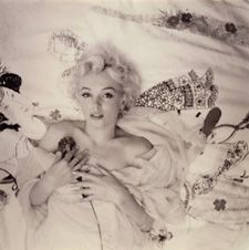 Marilyn Monroe  by Cecil Beaton, 1956  Courtesy Sotheby's  Beaton's images were known for elegance, style and glamour. This image represents the beauty and gentleness of women. The soft contrast and soft focus creates a desirable effect. By photographing this as a birds eye view Beaton is enhancing the vulnerability Monroe is portraying.  Beaton has captured a questioning look which adds to the mystery of Marilyn Monroe.
