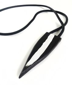 Visibly Interesting: Modern hand painted ebony shield pendant on leather by Neshka