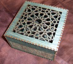 Laser cut box, cut and assembled from a single sheet of wood.