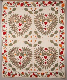 """Appliqued quilt, American, 3rd quarter-19th century, cotton. Folksy pattern of four large foliated hearts surrounded by red berries and additional hearts. Arcaded border.  76"""" x 91""""."""