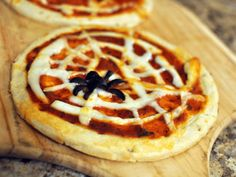 Spider web cheese pizza, with string cheese.  Healthy Halloween Treats Kids Will Love -