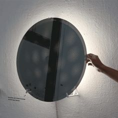 Hayo Gebauer's Moiré Mirror rotates  to reveal changing patterns